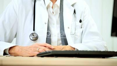 Senior Female Doctor in Consulting Rooms