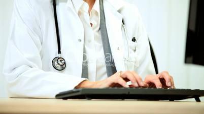Senior Female Medical Consultant with Computer