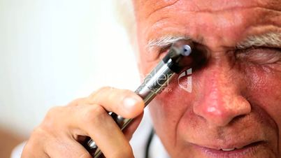 Senior Male Doctor Conducting Medical Examination