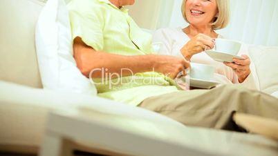 Senior Couple Enjoying Retirement Relaxing at Home