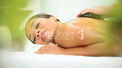 Health Spa Client Havng Hot Stone Massage Therapy
