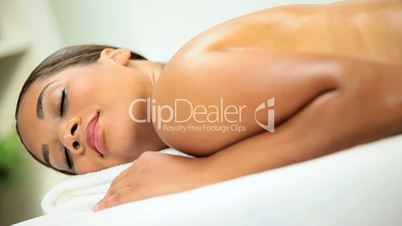 Female Spa Client Receiving Hot Stone Spa Massage