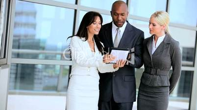 Three Multi Ethnic Business People with Wireless Tablet