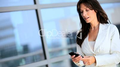 Ambitious Businesswoman Calling on Smartphone