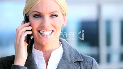 Female Business Executive with Smartphone in Close up
