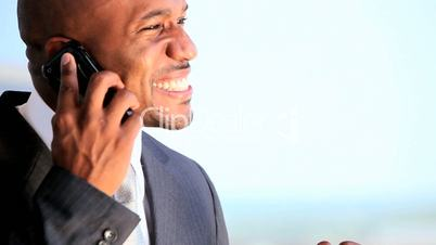 Male Business Executive Talking on Smartphone