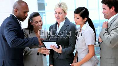 Multi Ethnic Business Team With Wireless Technology