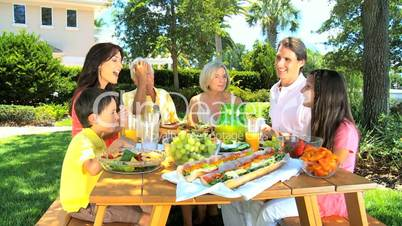 Family Generations Eating Healthy Lunch Together