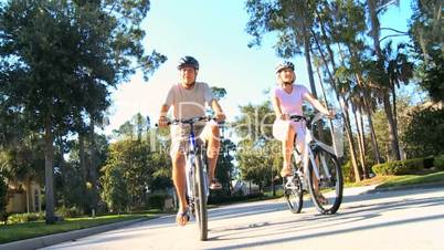 Senior Couple Keeping Fit by Cycling