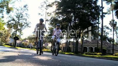 Senior Couple Exercising Outdoors on Bicycles