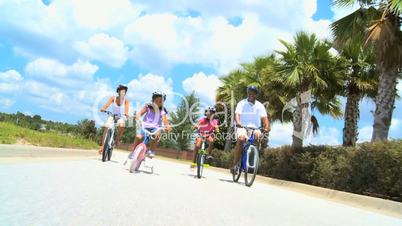 Healthy Ethnic Family Enjoying Cycling Together
