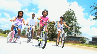 Young Ethnic Family Enjoying Cycling Together