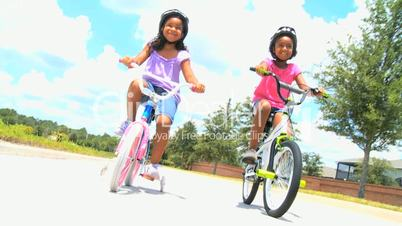Little African American Girls on Bicycles