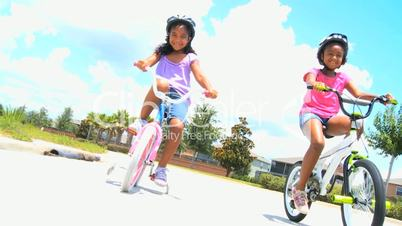 Cute Little African American Girls on Bicycles