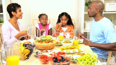 Ethnic Family Eating Healthy Food for Lunch