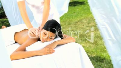 Beautiful Asian Girl Relaxing with Upper Body Massage