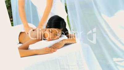 Young Asian Chinese Girl Receiving Massage Therapy