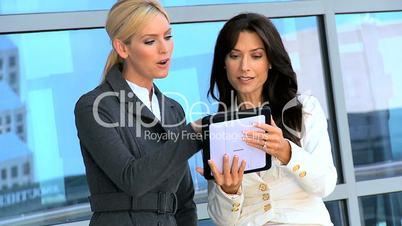 Smart Businesswomen with Wireless Tablet