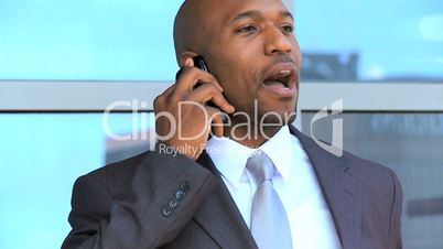 African American Executive Using a Smartphone Outdoors