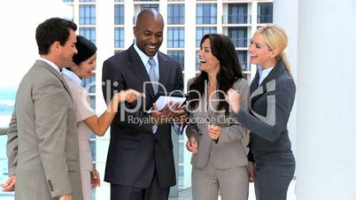 Business Team Get Good News from Wireless Tablet