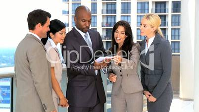 Multi Ethnic Business Team Using Wireless Tablet