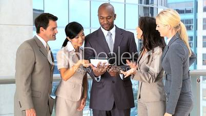 Multi Ethnic Business Team Using Modern Technology