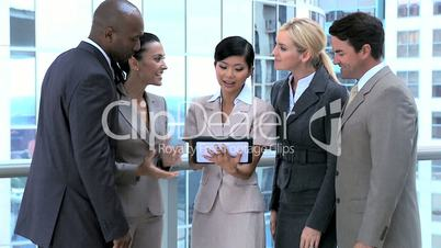 Ambitious Business Executives Using Wireless Tablet