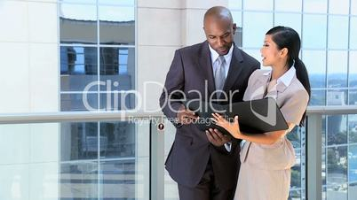 Multi Ethnic Business Executives with Work Portfolios