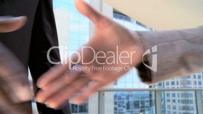 Handshake Between Multi Ethnic Business People