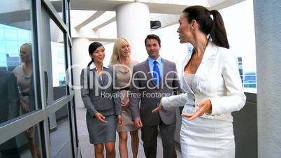 Female Business Executive Leading Team to a Meeting