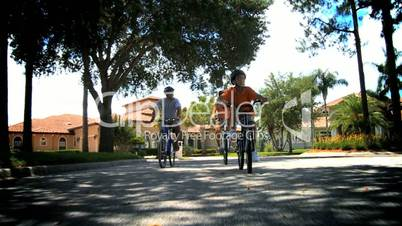 Healthy Ethnic Family Cycling Together