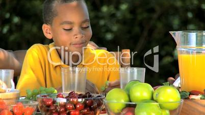 Little Ethnic Boy Enjoying Grapes with Lunch