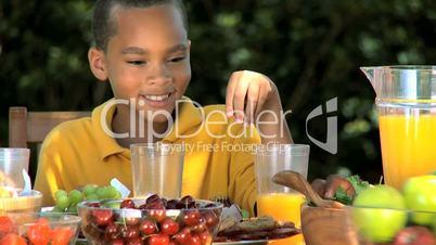 Little Ethnic Boy Enjoying an Apple with Lunch