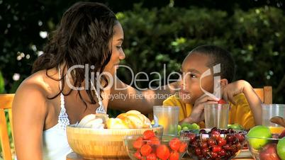 Young Ethnic Mother & Son Healthy Eating Lunch