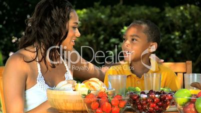 Young African American Mother & Son Healthy Eating