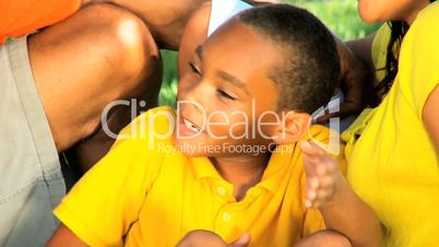 Loving African American Family Outdoors in Close up
