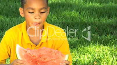 African American Child Eating Refreshing Water Melon