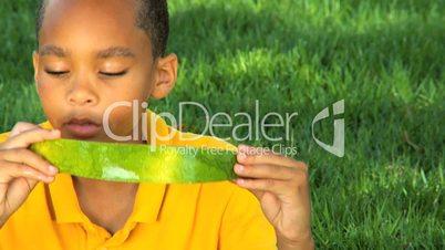 Young Ethnic Boy Enjoying Healthy Water Melon