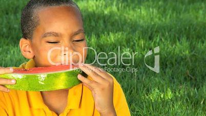 African American Child Enjoying Water Melon