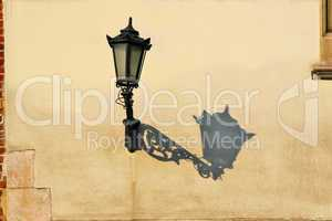 Wall with street lamp.