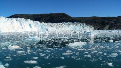 Arctic Glacier Stretching across a Frozen Sea