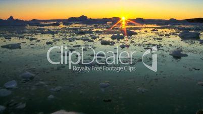 Sun Setting Over an Arctic Glacier