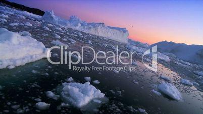 Arctic Sunset over Frozen Landscape