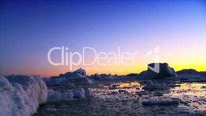 Sunset Over a Frozen Arctic Landscape