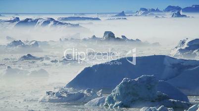 Pan Viiew of Freezing Air Lying Between Ice Floes
