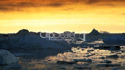 Ice Floes at Sunset in Moving Water