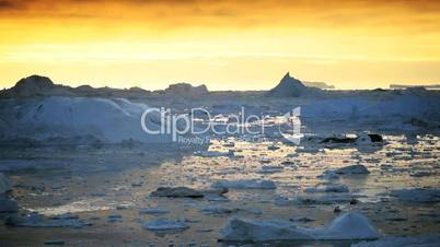 Small Craft at Sunset Sailing in Ice Floes
