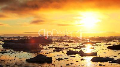 Golden Sunset over Melting Ice Floes