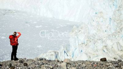 Lone Female on Hiking Expedition by a Glacier