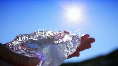 Hands Examining Glacial Ice
